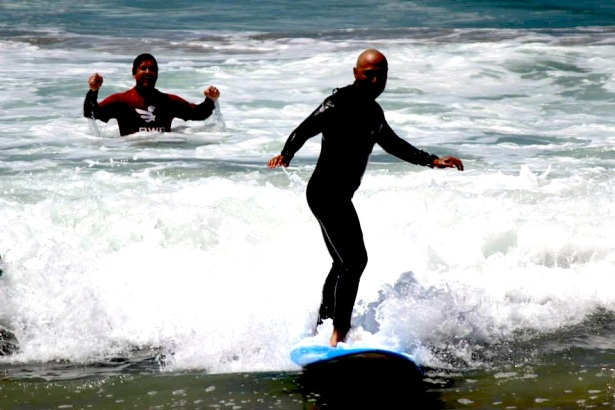 Jimmy helping a Veteran surf with Waves of Valor.
